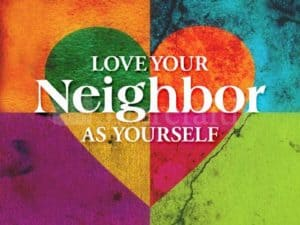 """A multicolored heart with the words """"love your neighbor as yourself"""" written across the heart."""