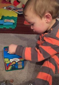 An image of a young child excitedly adding to his tzedakah box.