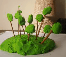 An image of trees made out of clay and sticks; an arts and crafts project.