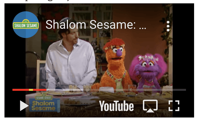 A screenshot of a youtube video from Shalom sesame, where two sesame street characters help a man cook food for shavuot.