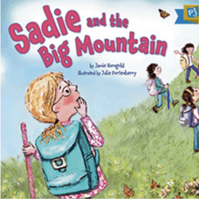 A book cover titled: Sadie and the Big Mountain. Sadie holds a walking stick and covers her mouth as she gazes up at the tall mountain she is about to climb. She is wearing a backpack and glasses and her friends in front of her have already begun to climb.