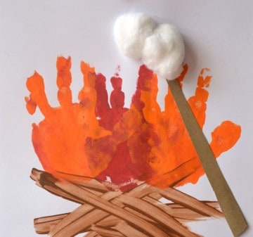 An arts and crafts project to make a campfire: with cotton as the marshmallows that are used to roast and orange hand prints for the fire!