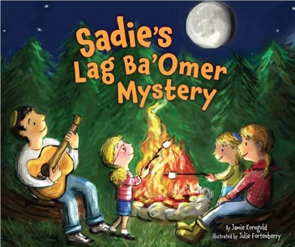 A book cover titled: Sadie's Lag B'omer Myster. On this cover, a family sits around a campfire; the father sings songs as he plays his guitar, and the mother helps her son roast a marshamallow.