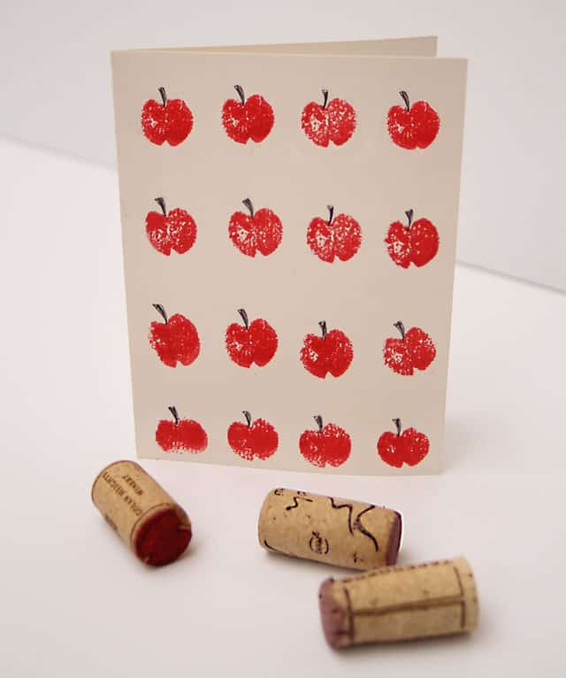 Crafts and games including corkscrews and a card with images of apples on it.