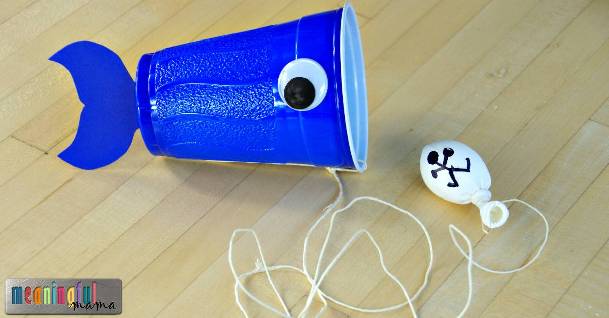 A plastic cup turned sideways with a googly eye on the side of it and string coming from one end - supposed to represent Jonah and the whale story!