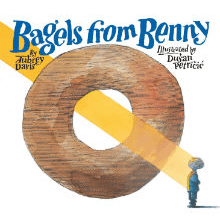 Illustrated book cover for Bagels from Benny. A giant bagel takes up most of the image, with a beam of light shining through the hole diagnonally and landing on a small child.