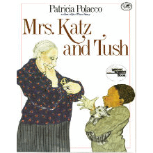 The illustrated book cover of Mrs. Katz and Tush. A young black boy holds a cat while talking with an older white woman.